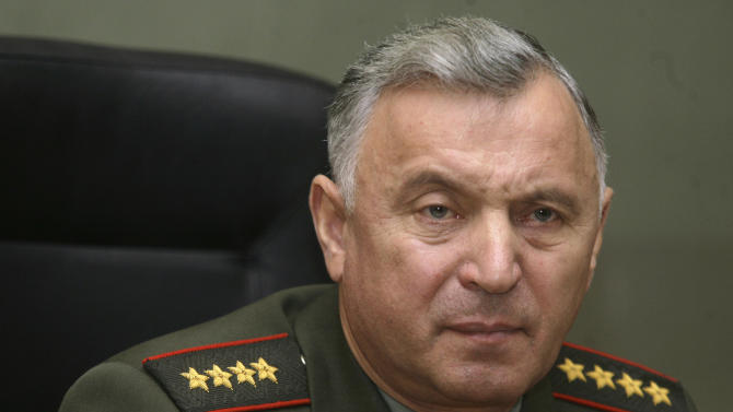 In this Dec. 10, 2008 file photo, Chief of the General Staff of the Russian armed forces  Gen. Nikolai Makarov meets with a military attache in Moscow. Russia is facing a heightened risk of being drawn into conflicts at its borders that have the potential of turning nuclear, the nation's top military officer said Thursday Nov 17 2011. (AP Photo/Mikhail Metzel, File)
