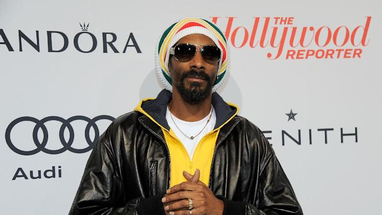 IMAGE DISTRIBUTED FOR THE HOLLYWOOD REPORTER - Snoop Dogg, AKA Snoop Lion, arrives at The Hollywood Reporter Nominees' Night at Spago on Monday, Feb. 4, 2013, in Beverly Hills, Calif. (Photo by Chris Pizzello/Invision for The Hollywood Reporter/AP Images)
