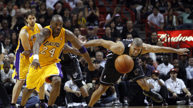Miami Heat's Shane Battier, right, loses the ball after it was batted away by Los Angeles Lakers' Kobe Bryant (24) during the second half of an NBA basketball game on Thursday, Jan. 19, 2012, in Miami. The Heat defeated the Lakers 98-87. (AP Photo/Lynne Sladky)