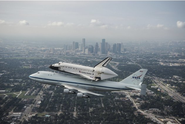 Handout of the space shuttle Endeavour, atop NASA's Shuttle Carrier Aircraft at it flies over Houston