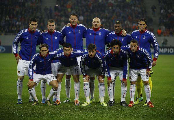 Basel team players pose for a photo before the UEFA Champions League group E soccer match between Steaua Bucharest and FC Basel, in Bucharest, Romania, on Tuesday, Oct. 22, 2013