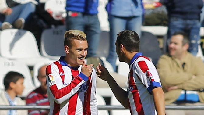 Atletico Madrid's Griezmann celebrates his goal against Deportivo Coruna with his teammate Koke during their Spanish First Division soccer match at Riazor stadium in Coruna