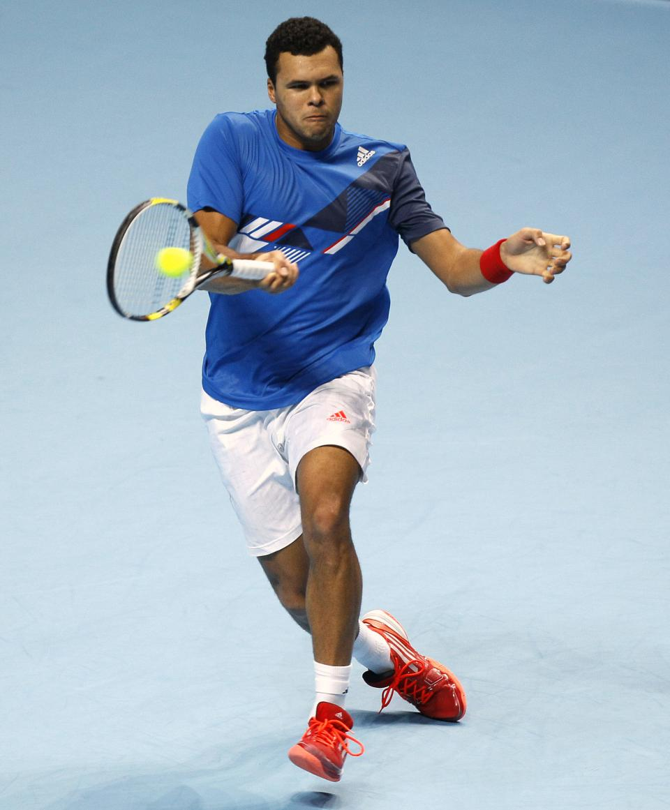 Jo-Wilfried Tsonga of France plays a return to Mardy Fish of the U.S. during their round robin singles tennis match at the ATP World Tour Finals at O2 Arena in London, Tuesday, Nov. 22, 2011.  (AP Photo/Kirsty Wigglesworth)