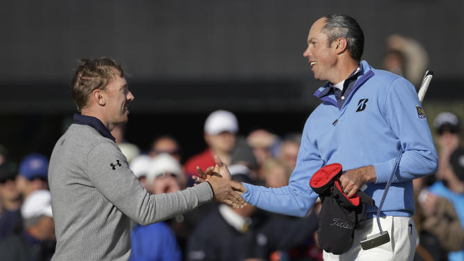 Hunter Mahan, left, congratulates Matt Kuchar after Kuchar won 2 and 1 in the final of the Match Play Championship golf tournament, Sunday, Feb. 24, 2013, in Marana, Ariz. (AP Photo/Ted S. Warren)