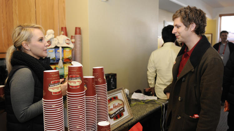 Actor Michael Cera visits the Tim Horton's Cafe & Bake Shop coffee bar at the Fender Music lodge during the Sundance Film Festival on Friday, Jan. 18, 2013, in Park City, Utah. (Photo by Jack Dempsey/Invision for Fender/AP Images)