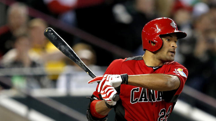 Canada's Tyson Gillies connects for a hit against Mexico during the first inning of a World Baseball Classic game, Saturday, March 9, 2013, in Phoenix. (AP Photo/Matt York)