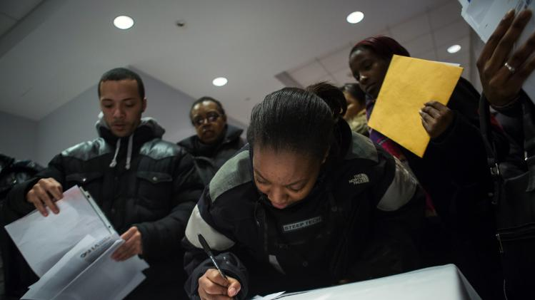 People attend a job training and resource fair at Coney Island in New York