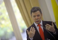 Colombian President Juan Manuel Santos, pictured on November 15, warned Colombia's Marxist FARC rebels they have less than a year to strike a deal under recently opened peace talks aimed at ending Latin America's longest-running insurgency