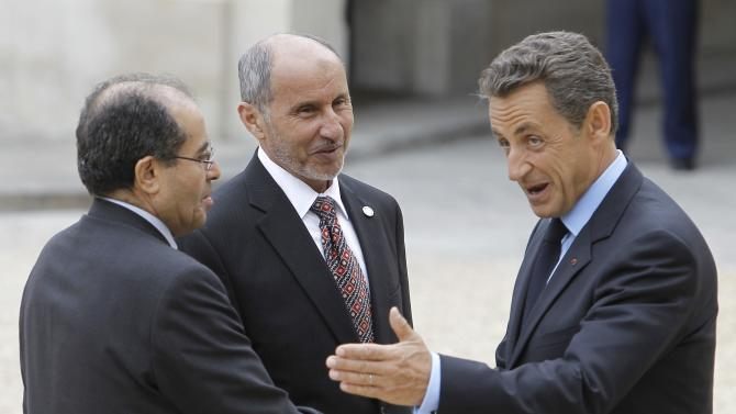 French President Nicolas Sarkozy, right, welcomes Libyan National Transitional Council  chairman Mustafa Abdel Jalil, center, and Libyan Transitional National Council Prime Minister Mahmoud Jibril, left,at the Elysee Palace in Paris, Thursday, Sept. 1, 2011. Heads of state and top officials gather in Paris to work out how to support Libya's opposition leaders after Gadhafi's fall from power. (AP Photo/Jacques Brinon)