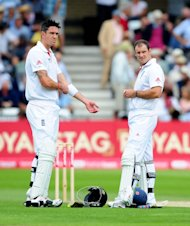 England's Andrew Strauss, right, has no plans to talk with Kevin Pietersen, left, any time soon