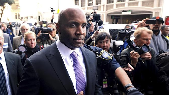 FILE - In this April 13, 2011, file photo, former baseball player Barry Bonds leaves federal court in San Francisco after being found guilty of one count of obstruction of justice. A federal appeals court will hear Bonds' appeal of the conviction early next year. The 9th U.S. Circuit Court of Appeals on Thursday, Dec. 13, 2012, scheduled oral arguments for Feb. 13 before a three-judge panel in San Francisco. (AP Photo/Noah Berger, File)