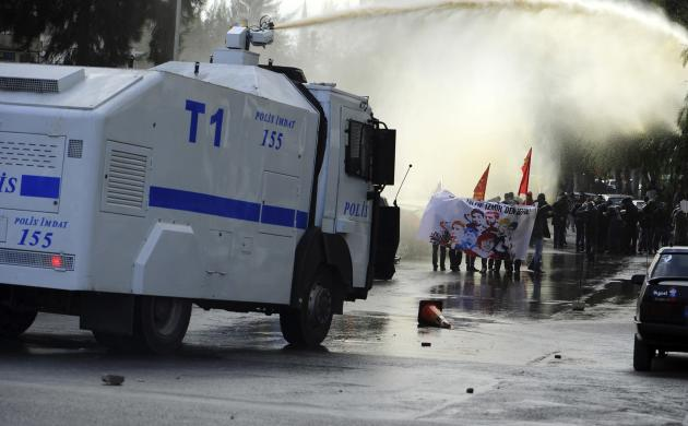 Riot police use water cannons to disperse demonstrators during an anti-government protest in the Aegean port city of Izmir