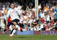Fulham's striker Dimitar Berbatov scores his second goal from the penalty spot during their English Premier League football match against West Bromwich Albion at Craven Cottage in London. Berbatov marked his Fulham home debut with two goals in a 3-0 Premier League victory over 10-man West Bromwich Albion