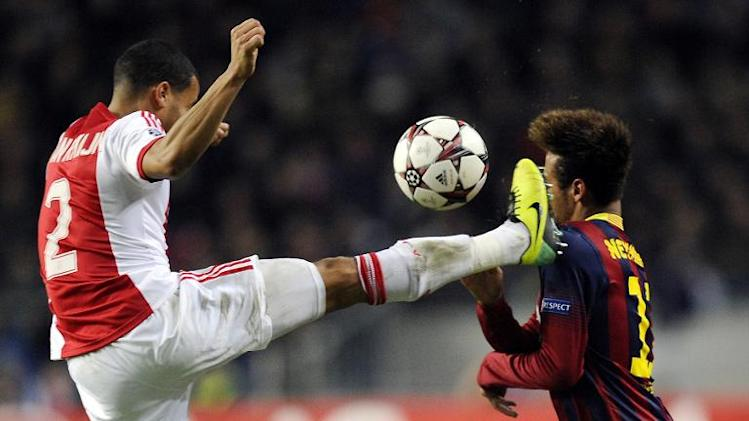 Ajax Amsterdam's Ricardo van Rhijn (L) fights for the ball with Barcelona's Neymar during their UEFA Champions League Group H match, at the Amsterdam Arena, on November 26, 2013