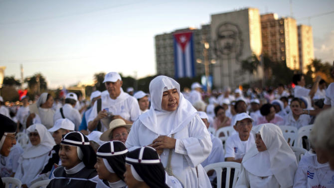 Nuns wait as worshippers gather in Revolution Square for the arrival of the Pope Benedict XVI  to celebrate a Mass in Havana, Cuba, Wednesday, March 28, 2012. Pope Benedict XVI wraps up his visit to Cuba on Wednesday with an open-air Mass in the shrine of the Cuban revolution.(AP Photo/Ramon Espinosa)