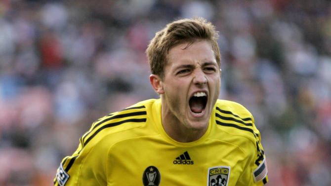 """FILE - In this Aug, 8, 2009 file photo, Columbus Crew's Robbie Rogers celebrates after scoring against the San Jose Earthquakes during the second half of an MLS soccer match in San Francisco. Former MLS and U.S. national team player Robbie Rogers says he is gay. In a post on his personal website, Rogers writes: """"Life is only complete when your loved ones know you. ... Try explaining to your loved ones after 25 years you are gay."""" (AP Photo/Marcio Jose Sanchez, File)"""