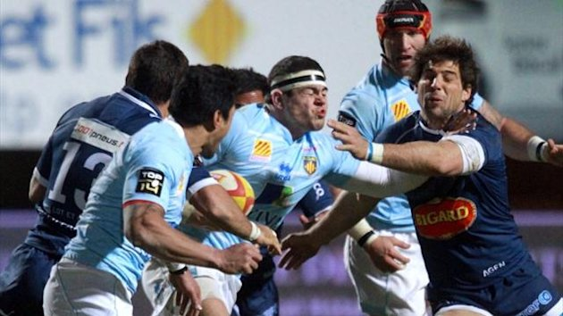Perpignan's French hook Guilhem Guirado vies with Agen's players (AFP)