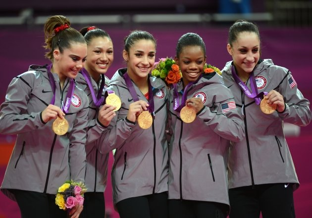 Gold medalist Team US Mckayla Maroney, Kyla Ross, Alexandra Raisman, Gabrielle Douglas and Jordyn Wieber celebrate  at the 02 North Greenwich Arena in London on July 31, 2012 -- Getty Premium