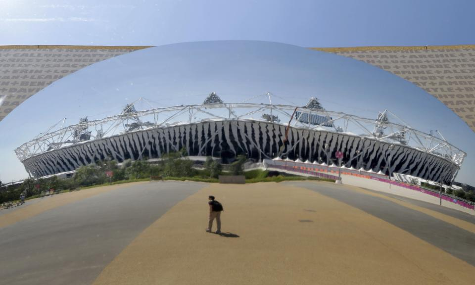 The Olympic Stadium is reflected on a round mirror three days ahead of the 2012 Summer Olympics, Tuesday, July 24, 2012, in London. (AP Photo/Daniel Ochoa De Olza)
