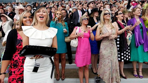 Racegoers cheer on their horses during the third day of Royal Ascot race meeting