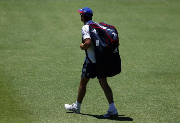 England's captain Cook walks onto the WACA ground carrying his kit before the start of a training session in Perth