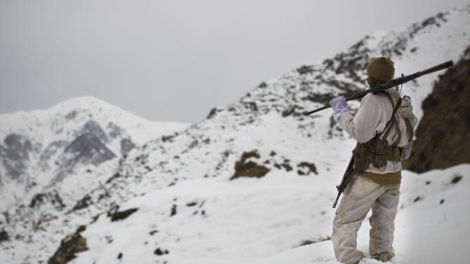 In this Friday, Feb. 17, 2012, photo, a Pakistani Army soldier with the 20th Lancers Armored Regiment patrols atop the 8000 foot mountain near their outpost at the Kalpani Base in Pakistan's Dir province on the Pakistan-Afghan border. Five years after setting up an umbrella organization to unite a violent symphony of militant groups operating in Pakistan's tribal regions, the Pakistani Taliban is fractured, strapped for cash and losing the support of a local population that is frustrated by a protracted war that has forced thousands out of their homes, say analysts and residents of the area. (AP Photo/Anja Niedringhaus)