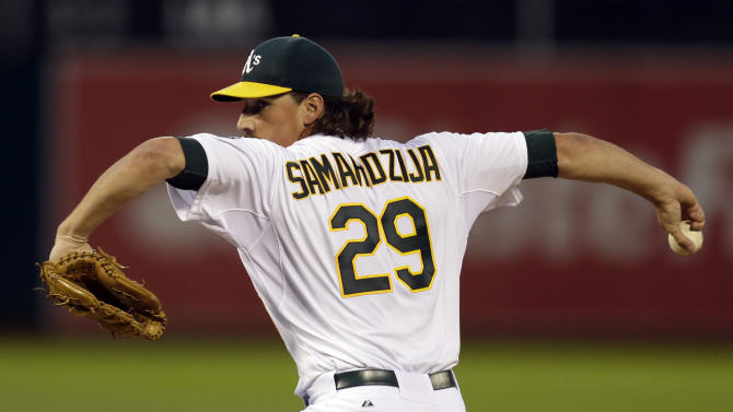 Doolittle blows save, A's lose 6-1 to Rangers