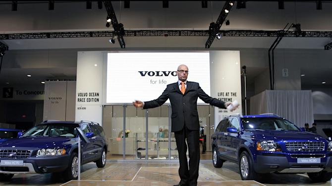 FILE - In this Wednesday, Jan. 25, 2006, file photo, Hans Krondahl, EVP, Marketing, Volvo Cars of North America, introduces the new Volvo VOR XC90, right, and the VOR XC70, left, limited edition during its global launching at the Washington Auto Show. Volvo said on Wednesday, Nov. 6, 2013, it will hire a new ad agency and work on a bolder message emphasizing Volvo's reputation for safety. One idea that could make it into the company's ads: Volvo's internal goal of having no deaths or serious injuries in new Volvo cars by 2020. (AP Photo/Manuel Balce Ceneta, File)