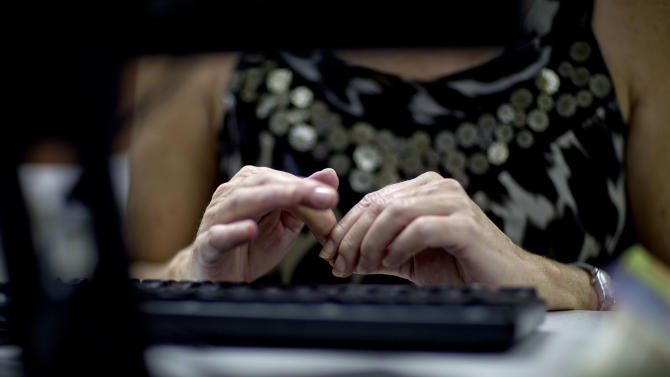 "In this Aug. 22, 2012 photo, Mary Guess, of Dalton, Ga., pauses for a moment while typing on a keyboard as she files for unemployment, in Dalton, Ga. Collapsing industry or not, Dalton city officials are still the proud owners of the label ""Carpet Capital of the World,"" but what they aren't happy about is the most recent label: The city that is leading the nation in the number of job losses per capita this year. The city that makes nearly 75 percent of the nation's flooring has lost 4,600 jobs between June 2011 and June 2012 according to the United States Bureau of Labor Statistics. Dalton's economy hit bottom in 2009 with the collapse of the housing market, taking hundreds of distributor business and support services down with it and struggling to recover in recent years. (AP Photo/David Goldman)"