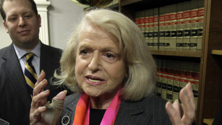 Edith Windsor, center, is interviewed at the offices of the New York Civil Liberties Union, in New York, Thursday, Oct. 18, 2012. A federal appeals court in Manhattan has become the second in the nation to strike down the Defense of Marriage Act as unconstitutional. The ruling came in a case brought by Windsor. She sued the government in November 2010 because she was told to pay $363,053 in federal estate tax after her partner of 44 years died in 2009. (AP Photo/Richard Drew)
