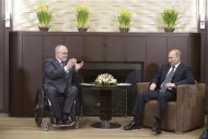 Russia's President Vladimir Putin (R) meets with President of the International Paralympic Committee Philip Craven at the Bocharov Ruchei state residence in Sochi, March 11, 2014. REUTERS/Alexei Nikolskyi/RIA Novosti/Kremlin