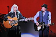 Musicians Emmy Lou Harris, left, and Rodney Crowell perform at &quot;Play It Forward: A Celebration of Music&#39;s Evolution and Influencers&quot; at the Grammy Foundation&#39;s 15th Annual Music Preservation Project, Thursday, Feb. 7, 2013, in Los Angeles. (Photo by Vince Bucci/Invision/AP)
