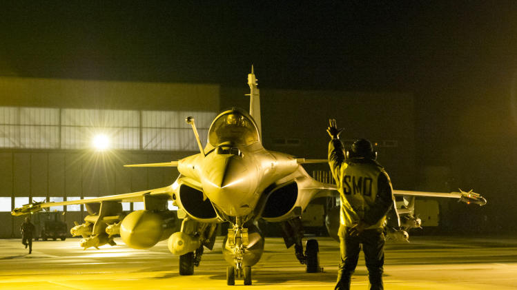 This Sunday Jan.13, 2013 photo provided by the French Army Monday Jan.14, 2013 shows  French Rafale jetfighters being prepared before heading to Mali  from the Saint Dizier airbase, eastern France. French fighter jets bombed rebel targets in a major city in Mali's north Sunday, pounding the airport as well as training camps, warehouses and buildings used by the al-Qaida-linked Islamists controlling the area, officials and residents said. (AP Photo/Laure-Anne Maucorps, ECPAD)