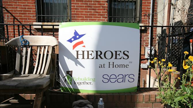 Signage for Rebuilding Together in Red Hook-Heroes at Home Kick-off during Superstorm Sandy on Friday, May 10, 2013 in Red Hook, Brooklyn. Rebuilding Together, with the support of Sears, will be completely renovate this destroyed floor so the homeowner can move back in and age safely in place. (Amy Sussman/AP Images for Rebuilding Together)