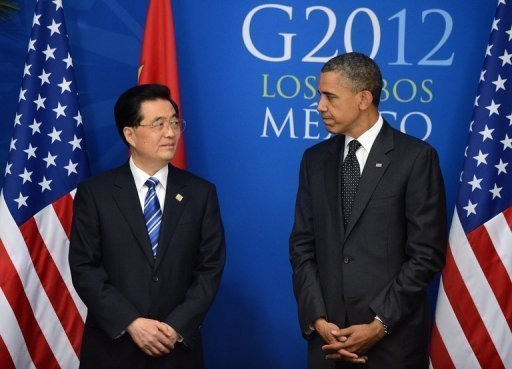<p>US President Barack Obama (R) with Chinese President Hu Jintao before a bilateral meeting in Los Cabos, Mexico, on June 19, on the sidelines of the G20 summit. After years of pressure to take a greater role in global affairs, China and India have stepped up by contributing to a new IMF emergency fund -- from which the United States is absent.</p>