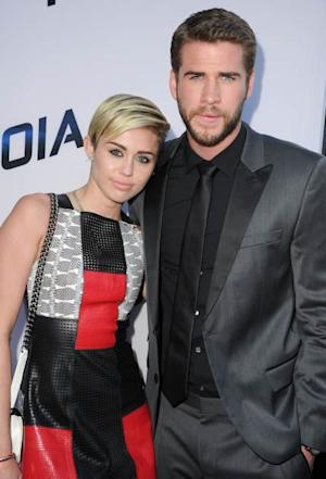 Miley Cyrus and Liam Hemsworth -- Getty Premium