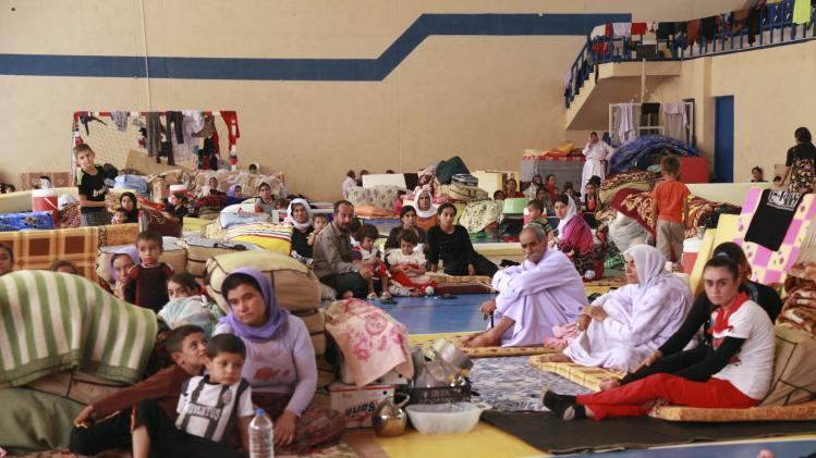 Displaced people from the minority Yazidi sect, fleeing violence in the Iraqi town of Sinjar west of Mosul, take refuge at Dohuk