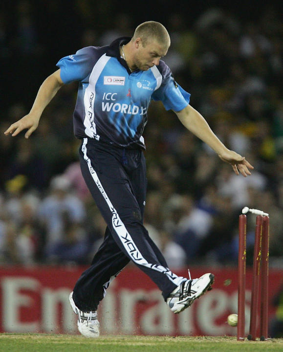 MELBOURNE, AUSTRALIA - OCTOBER 7: Andrew Flintoff of the World XI attempts a run out by kicking the ball at the stumps during the Australia v ICC World XI match at the Telstra Dome October 7, 2005 in
