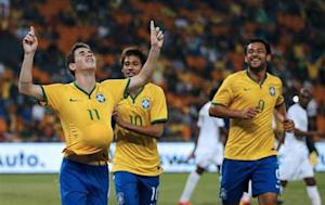 Brazil's Oscar celebrates his goal against South Africa with his team mates Neymar and Fred during their international friendly soccer match at the First National Bank Stadium, also known as Soccer City, in Johannesburg