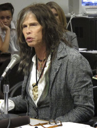 FILE - This Feb. 8, 2013 file photo shows Aerosmith lead singer Steven Tyler testifying on celebrity privacy during a hearing at the Hawaii Capitol in Honolulu. The Hawaii state Senate plans to vote on a bill aimed at protecting celebrities and other public figures from unwanted media attention. The so-called Steven Tyler Act would create a civil violation for people who take photos or videos of others private moments. (AP Photo/Oskar Garcia, file)