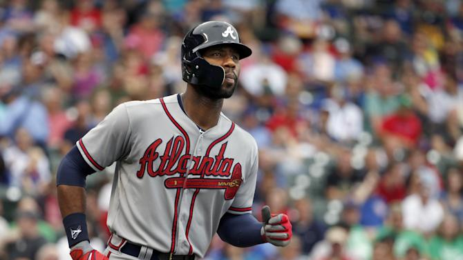 Braves beat Cubs 9-5 to reduce magic number to 1