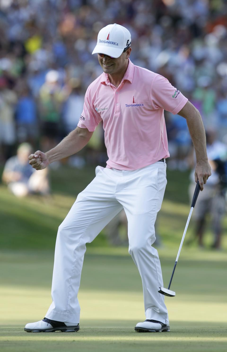 Zach Johnson reacts after winning the John Deere Classic golf tournament at TPC Deere Run, Sunday, July 15, 2012, in Silvis, Ill.  Johnson defeated Troy Matteson in a playoff. (AP Photo/Charlie Neibergall)