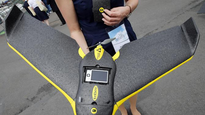 A Parrot eBee, an ultra light civil professional drone used to shoot video and photos is displayed during the 50th Paris Air Show at Le Bourget airport, north of Paris, Tuesday, June 18, 2013.  (AP Photo/Francois Mori)