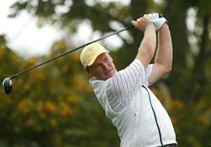 International team member Ernie Els of South Africa hits off the fifth tee at the 2013 Presidents Cup golf tournament at Muirfield Village Golf Club in Dublin, Ohio