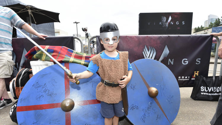 "IMAGE DISTRIBUTED FOR THE HISTORY CHANNEL - Young VIKINGS fan, Dominic Doan, poses in costume at HISTORY's ""On the Set with VIKINGS"" interactive experience outside the 2014 Comic-Con International Convention on Friday, July 25, 2014 in San Diego. Throughout the weekend, fans got a behind-the-scenes look at VIKINGS and a starring role in their own custom video. (Photo by Denis Poroy/Invision/AP)"