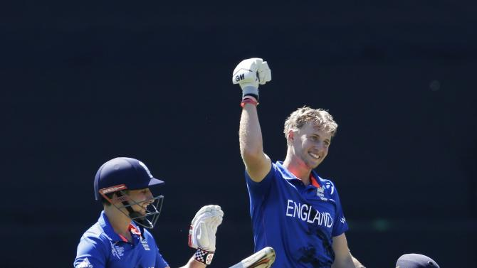 England's Taylor reacts next to team mate Root who celebrates reaching his century during their Cricket World Cup match against Sri Lanka in Wellington