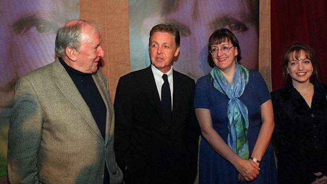 FILE - In this Thursday, April 27, 2000 file photo Paul McCartney, second left, speaks with composers Sir Richard Rodney Bennett, left, Roxanna Panufnik, second right, and Judith Bingham before a benefit dinner for the Garland Appeal in New York. Sir Richard Rodney Bennett, a British composer, pianist and arranger who was nominated three times for Academy Awards, has died in New York City at age 76. His publisher Novello & Co. said in a statement Friday Dec. 28, 2012 that Bennett died on Dec. 24 following a brief illness. (AP Photo/Stephen Chernin, file)