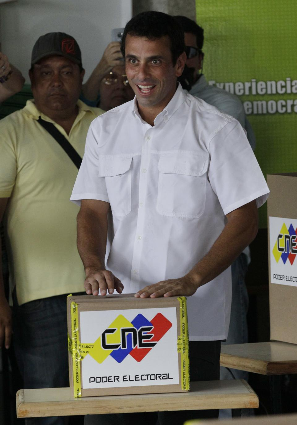 Opposition presidential candidate Henrique Capriles casts his ballot in the presidential election in Caracas, Venezuela, Sunday, Oct. 7, 2012. Capriles is running against President Hugo Chavez. (AP Photo/Ariana Cubillos)