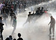 Police unleash water cannon during a protest calling for better safety for women, following a gang-rape of a student last week, in front of the Government Secretariat and Presidential Palace in New Delhi, on December 22, 2012. India said Saturday it may consider using the death penalty to punish rapists