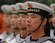 <p>Chinese sailors form an honour guard as they wait for the arrival of Singapore Prime Minister Lee Hsien Loong at the Great Hall of the People in Beijing on September 6. Chinese Vice President Xi Jinping missed Lee's visit, along with several other scheduled meetings, giving rise to speculation over his health</p>